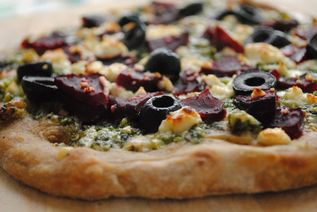 Whole Wheat Winter Pizza with Arugula Pesto and Roasted Beets